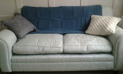 Green throw and 2 cushions